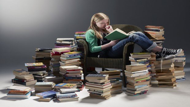 how to declutter your life-replace a pile of books with an ebook reader