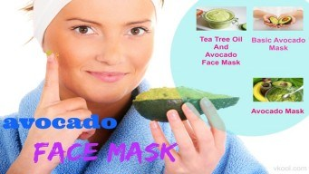 A portrait of a young woman applying natural avocado mask on her face