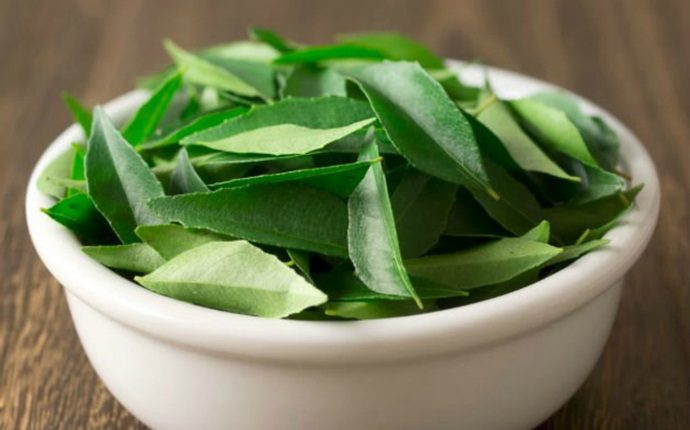 how to get rid of dry hair - curry leaves and coconut oil