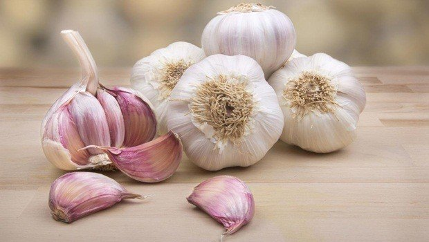 how to treat sprained ankle - garlic, coconut oil, and almond oil