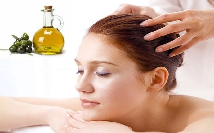 olive oil for scalp - warm olive oil massage for scalp treatment