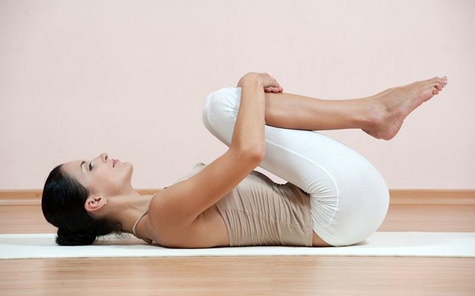 yoga poses for back pain - apanasana or knees to chest pose