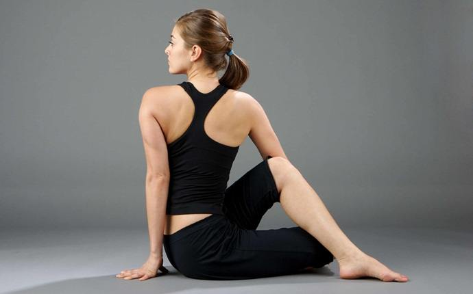 yoga poses for back pain - ardha matsyendrasana or half fish god pose