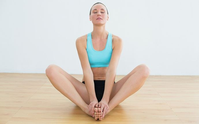 yoga poses for back pain - baddha konasana or butterfly pose