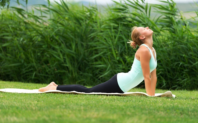 yoga poses for back pain - bujanghasana or cobra pose