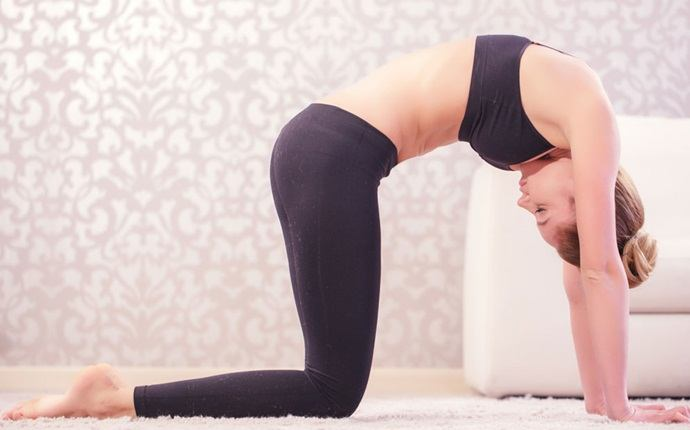 yoga poses for back pain - marjariasana or cat pose