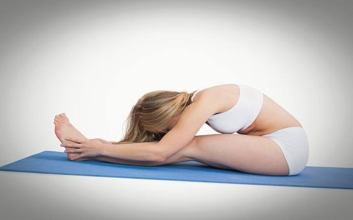 yoga poses for back pain - pashchimottanasana or seated forward bend pose