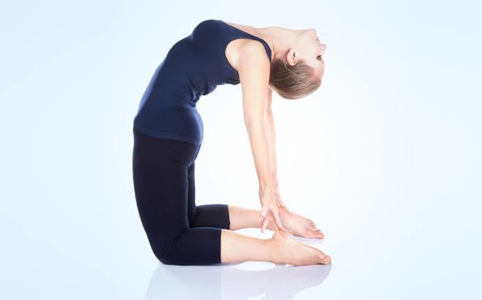 yoga poses for back pain - supta vakrasana or reclining spinal twist pose