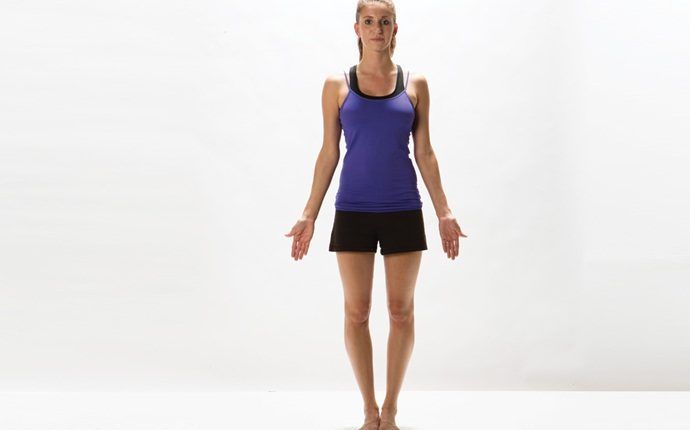 yoga poses for back pain - tadasana or mountain pose