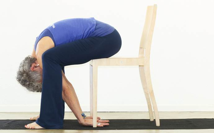yoga poses for sciatica - cow in a chair