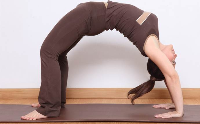 yoga poses for sciatica - dhanur asana or the bow pose