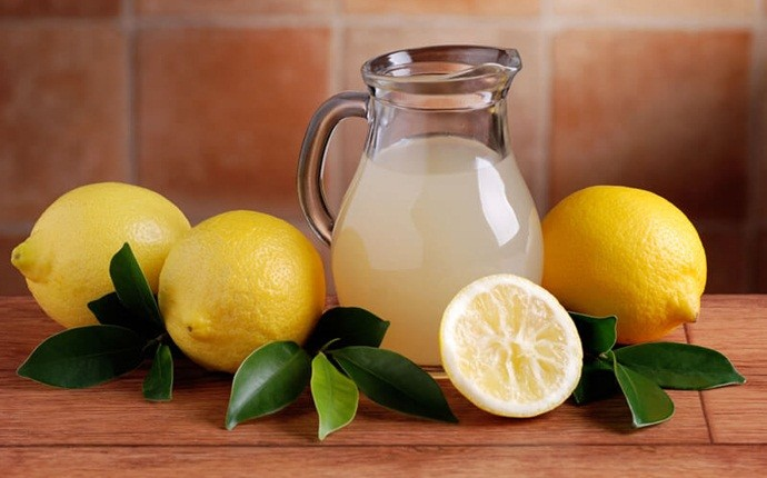 how to reduce dandruff - lemon juice with fuller's earth