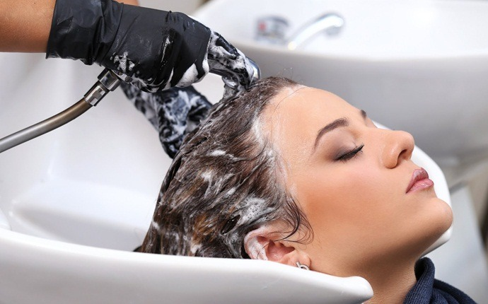 how to reduce dandruff - shampoo regularly
