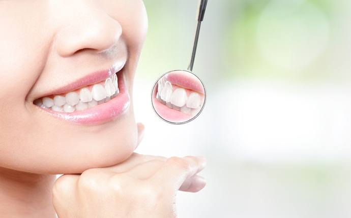 how to look young - maintain healthy teeth
