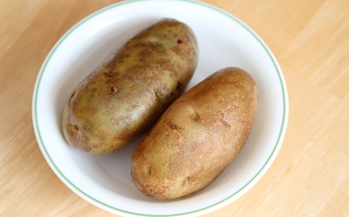 how to get rid of swollen lip - potato